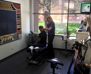 Dr. Gail Warner Examining a Patient